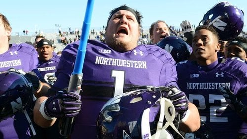 Northwestern Football Player Holding Lightsaber